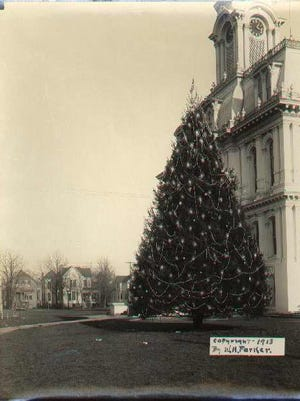 The Norway spruce is seen on the Marion County Courthouse lawn in 1913. The tree reportedly was the first live outdoor-lighted Christmas tree in the United States.