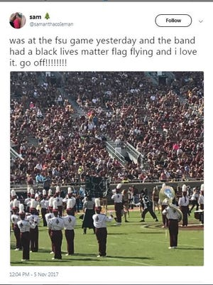 This Twitter post shows the Black Lives Matter flag being unfurled at the Marching Chiefs performance.