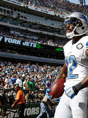 Lions receiver Jeremy Ross celebrates his touchdown in Sunday's win over the Jets.