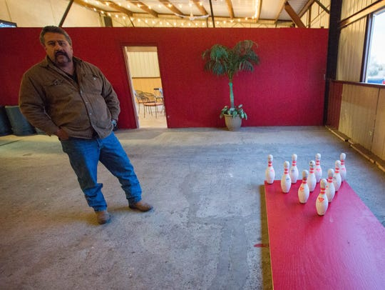 Victor Perez, co-owner of the Beverly Hills Hall and Cantina, stands in one of the patio areas where customers can play games like Endzone Bowling and corn hole. Thursday January 4, 2018.