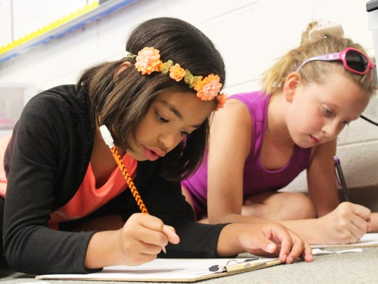 Kaydence Reisner and Amber Sims focus on their classwork.