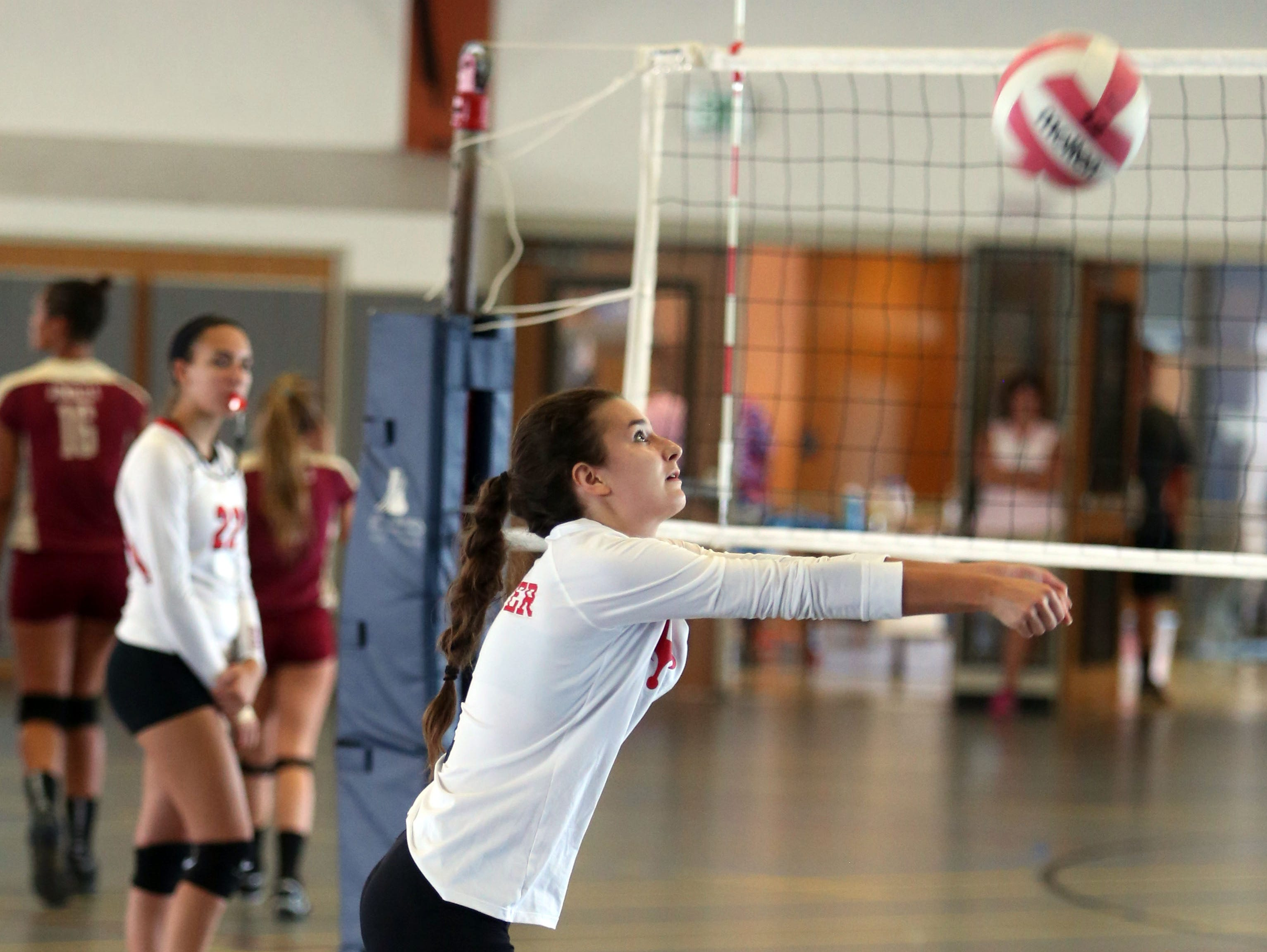 Arielle Putter with the Fox Lane High School Volleyball team, returns a shot against Millbrook during the Breast Cancer Awareness tournament at Hendrick Hudson High School in Montrose, Sept, 10, 2016.