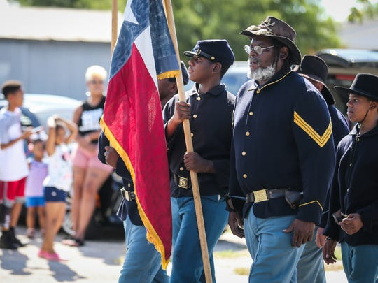 Buffalo Soldiers lead the Juneteenth parade Saturday, June 16, 2018, along Martin Luther King Drive.