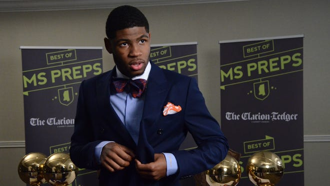 Malik Newman buttons his coat Friday at The Clarion-Ledger just before announcing his commitment to play basketball at Mississippi State.