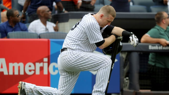 Todd Frazier reacts after a child was hit by a foul ball off his bat .