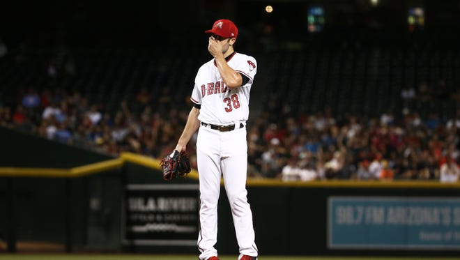 Arizona Diamondbacks pitcher Robbie Ray reacts after giving-up four runs to the St. Louis Cardinals in the 1st inning on July 2, 2018, at Chase Field in Phoenix, Ariz.
