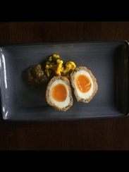 The Scotch egg is the standout appetizer at Farmers