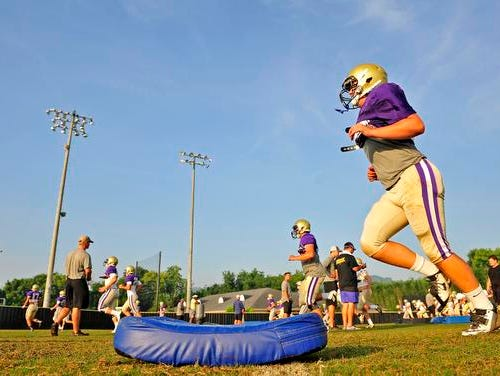 Christ Presbyterian Academy players go through drills during practice Monday.