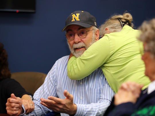 Rachel Dildilian of Hyde Park comforts Dennis Berkley