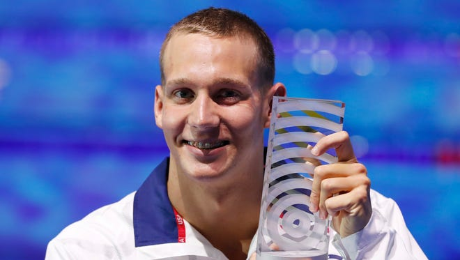United States' Caeleb Remel Dressel who won 7 gold medals shows off the award as best male athlete during the swimming competitions of the World Aquatics Championships in Budapest, Hungary, on July 30.