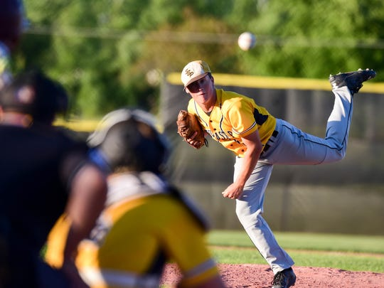 Southeast Polk pitcher Thomas McLaughlin (14) releases a pitch Monday during a baseball game between Southeast Polk and Ankeny at Ankeny High School. Ankeny won 4-1.