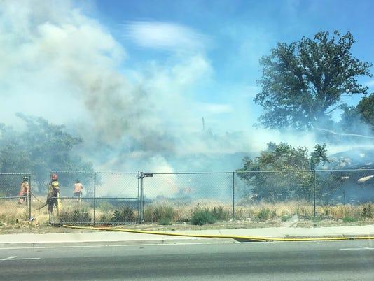 Reno firefighters battle brush fire on Wells Avenue
