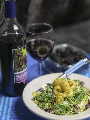 Blackberries and a kale and Brussels sprouts salad is paired with Stonehaus Winery's Blackberry Summer wine.