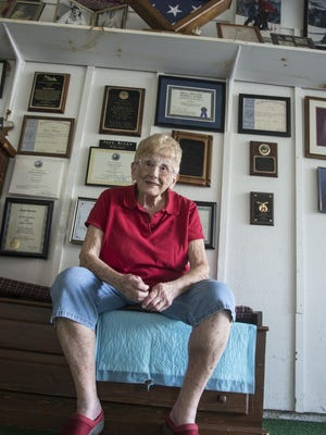 In her garage, Joan Brown keeps many of the plaques and citations she's been awarded for her many years of volunteer work.