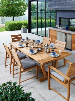 Gloster's Oyster Reef collection features a teak farmhouse-style table. Rustic modern pieces are part of a growing trend toward pieces that work both indoors and out.