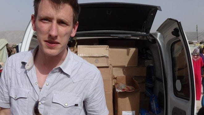 Peter Kassig of Indianapolis stands in front of a truck filled with supplies for Syrian refugees. He changed his name to Abdul-Rahman Kassig after he converted to Islam during his captivity.