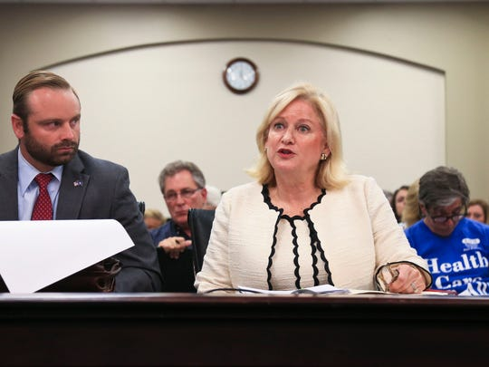 Vickie Yates Brown Glisson, secretary of the Cabinet for Health and Human Services, says she believes the changes will strengthen Medicaid. At left is Adam Meier, the chief of staff for policy for Gov. Matt Bevin. The two introduced the proposed Medicaid changes during a hearing Monday morning in Frankfort.