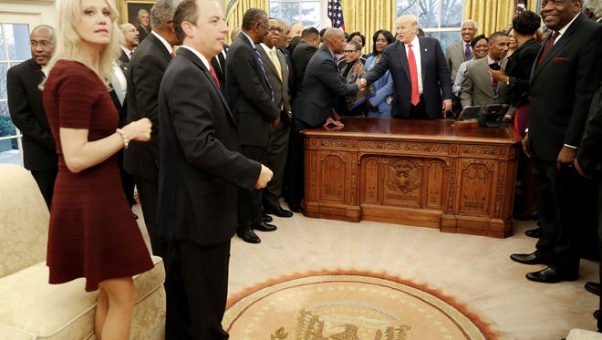 President Donald Trump, center, meets with leaders of Historically Black Colleges and Universities (HBCU) in the Oval Office of the White House in Washington, Monday, Feb. 27, 2017. Also at the meeting are Counselor to the President Kellyanne Conway, left, and White House Chief of Staff Reince Priebus. (AP Photo/Pablo Martinez Monsivais)