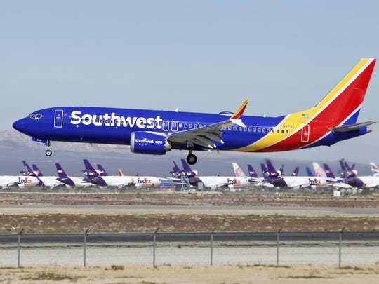 Southwest, the biggest operator of Boeing jets, is removing the grounded 737 Max from its schedule until at least Aug. 5, well past the peak of the summer high season.