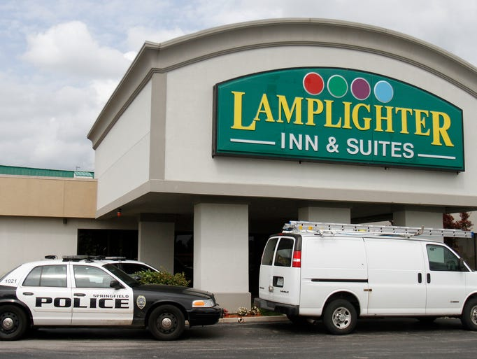 Police cars sit outside the Lamplighter Inn during a standoff with a man inside a room in the hotel on Thursday, June 19, 2014.