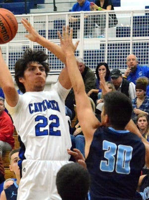 Cavemen senior shooting guard Micah Calderon knocks down a midrange shot in the third quarter Tuesday against Goddard.