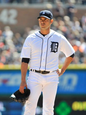 Tigers pitcher Anibal Sanchez waits while manager Brad Ausmus makes his way to the mound for a pitching change in the fourth inning of his start last week against the White Sox.