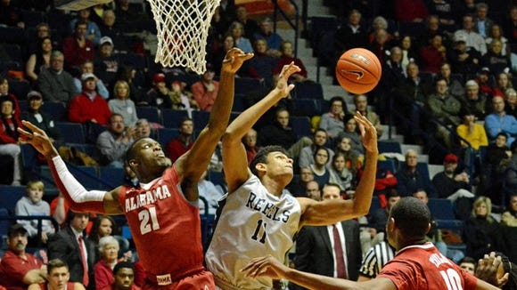 Mississippi forward Sebastian Saiz (11) battles Alabama guard Rodney Cooper (21) and forward Jimmie Taylor (10) for a rebound during an NCAA college basketball game in Oxford, Miss., Wednesday, Feb. 26, 2014. Mississippi won 79-67. (AP Photo/Thomas Graning)