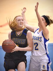 Madelyn Curtis of Cathedral drives to the basket during