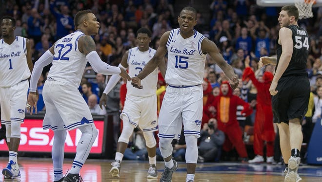 Seton Hall Pirates guard Derrick Gordon (32) and guard Isaiah Whitehead (15) celebrate against the Xavier Musketeers during the second half at Prudential Center. The Pirates won, 90-81.