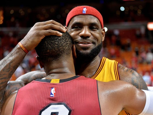 LeBron James hugs Dwyane Wade after the Heat defeated