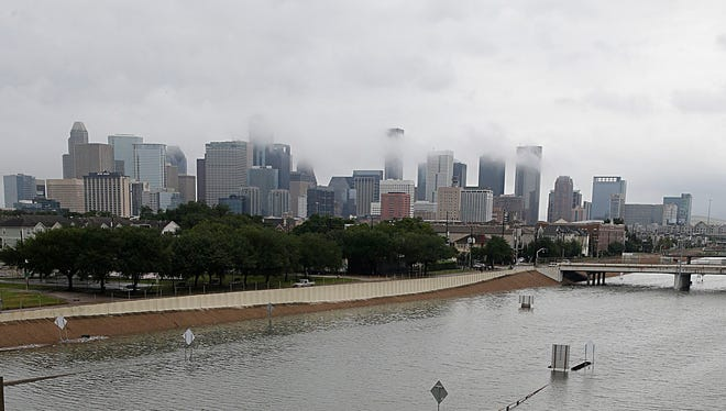 The downtown Houston skyline and a flooded highway are seen Aug. 27, 2017, as the city battles with the remnants of Harvey and its resulting floods.