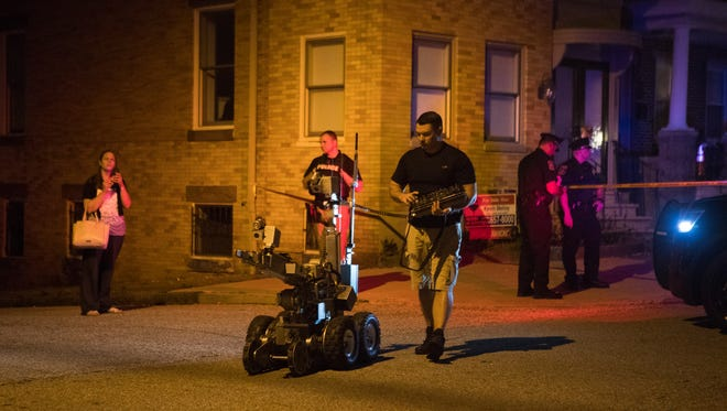 Wilmington Police investigate the scene of a suspicious package found on the 1500 block of West 7th Street Monday night.