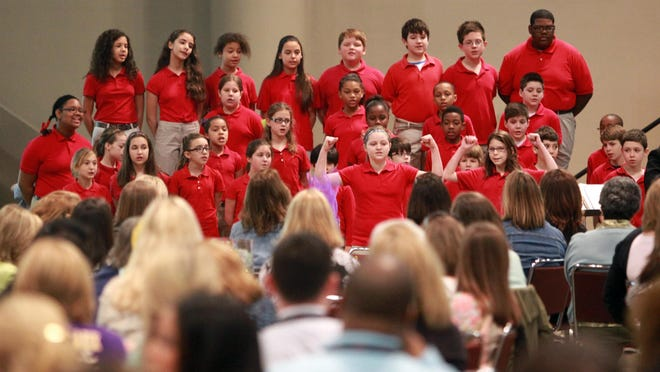 Plantation Elementary students sing during a Leader In Me symposium in February 2014.