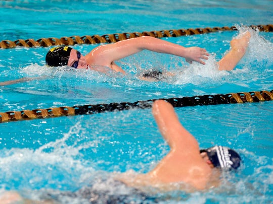 Red Lion's Dylan North, top, swims to victory in the 200-yard freestyle during Thursday's meet.