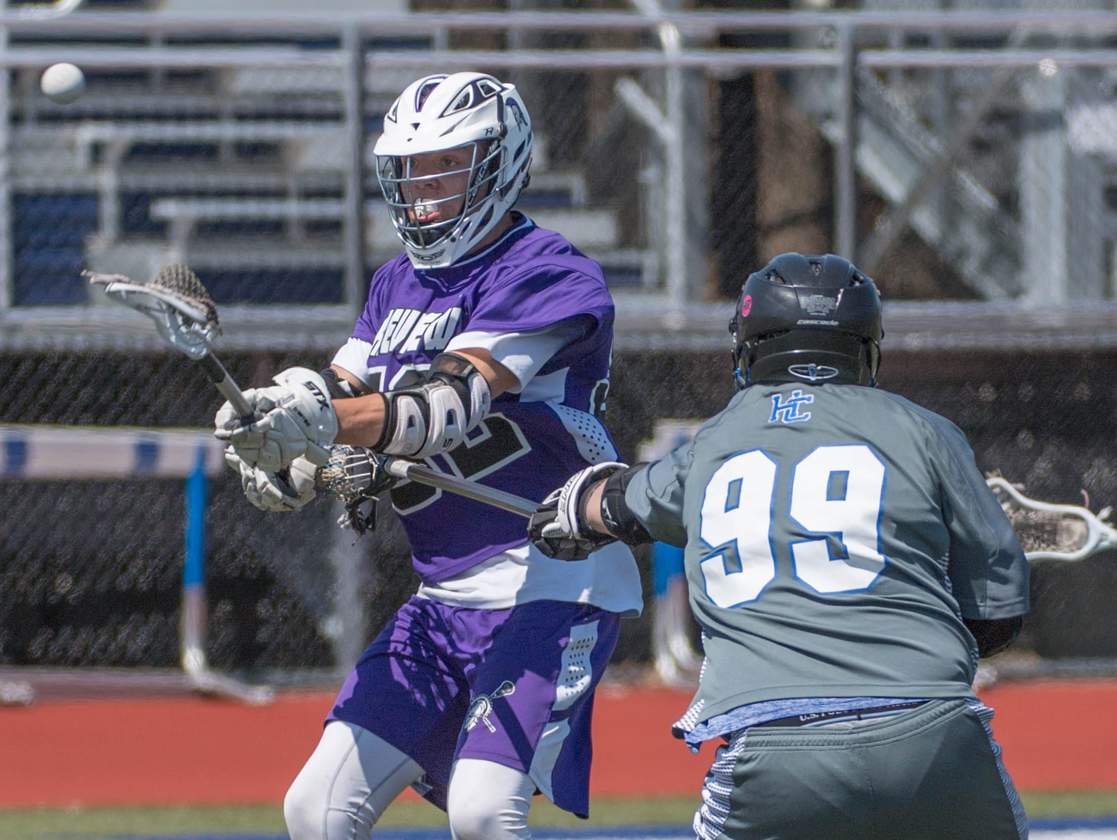 Lakeview's Jerry Haadsma (52) advances the ball against Harper Creek in the All City Lacrosse Tournament on Saturday.