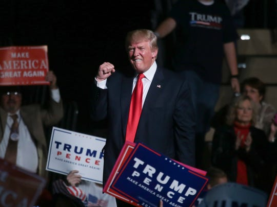 Republican Presidential candidate Donald Trump pumps