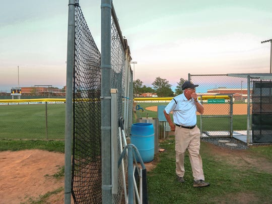 Gary Adams, softball coach at Crescent High School, is one of the last to leave after beating Hanahan 2-0 in the first game of the Class AAA Softball State Series in Iva on Monday. Adams surpassed 1,000 wins recently.