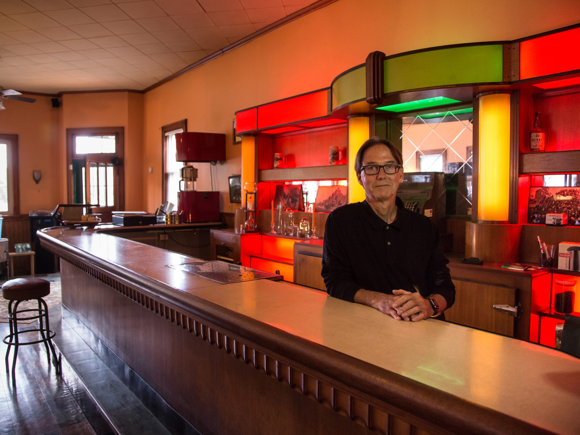 Mike Mallow, 69, stands inside the Art Deco bar he
