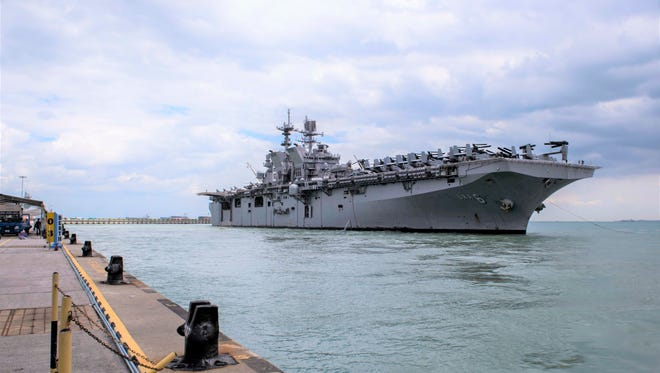 The USS America, shown here in a recent port visit to Singapore, is visiting Guam this week.