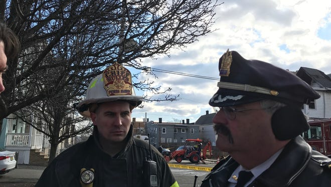 Perth Amboy Fire Chief Ed Mullen (left) and Deputy Police Chief Larry Cattano at the site of Friday morning's fatal fire in Perth Amboy.