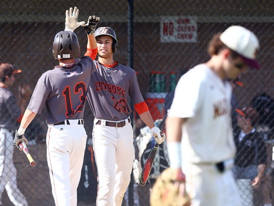 Pascack Hills Chris Curcio is high-fived by teammate