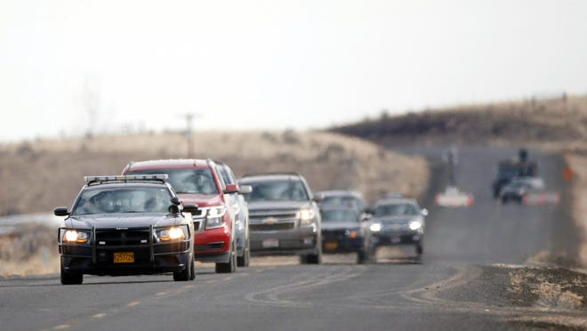 Authorities lead a caravan of the final four occupiers of the Malheur National Wildlife Refuge through the Narrows roadblock, Thursday, near Burns. The last four occupiers of a national wildlife refuge in eastern Oregon surrendered Thursday. The holdouts were the last remnants of a larger group that seized the wildlife refuge nearly six weeks ago, demanding that the government turn over the land to locals and release two ranchers imprisoned for setting fires.