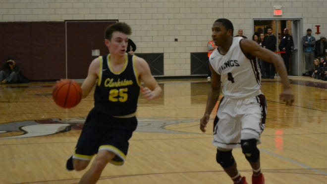 Clarkston's Nick Wells drives the lane against Hazel Park's Kyle Washington during Clarkston's 70-39 win on Tuesday, Jan. 30, 2018, at Hazel Park.