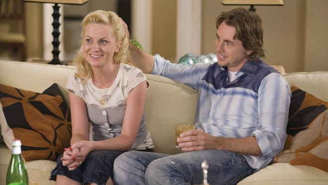 """Amy Poehler and Dax Shepard co-star in 2008's """"Baby Mama."""""""