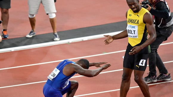 Justin Gatlin bows to Usain Bolt after upsetting the