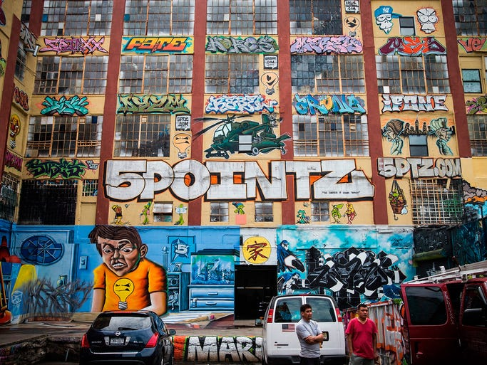 A photograph taken on Aug. 9 shows graffiti art on the 5 Pointz building in Queens, N.Y. Artists are attempting to have the structure saved as a historic landmark while the owner wants it torn down to develop high-rise apartments. The building attracted international artists.