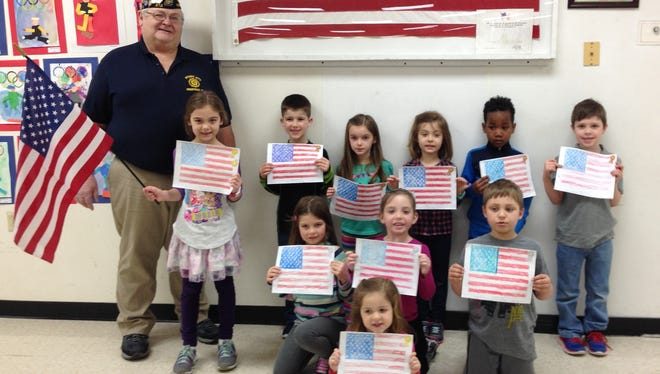 The Forestville/Maplewood American Legion announced the winners of its coloring contest in the kindergarten class at Southern Door Elementary School.  Back row, from left, are Legion member Allen Buechner, Amber Geisel, Eli Walker, Ember Madden, Avery Delwiche, DeMauri Parks and Liam Van Oss.  Middle row, from left, are Addison Wessel, Mayleigh Severinsen and Vincent Richardson.  In front is Sawyer Soukup. Not in the photo is Brielle Spude..