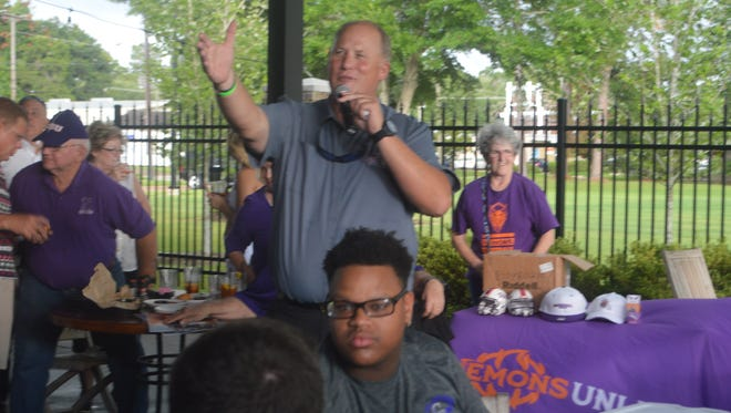 NSU coach Jay Thomas speaks to the crowd at the NSU Victory Tour at Spirits on Monday.