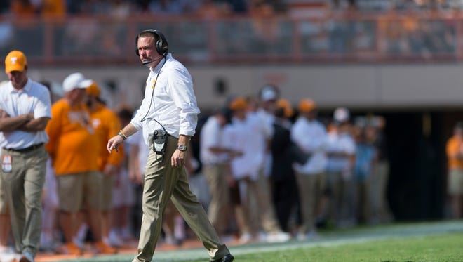 Vols coach Butch Jones walks off the field during Saturday's game against South Carolina.