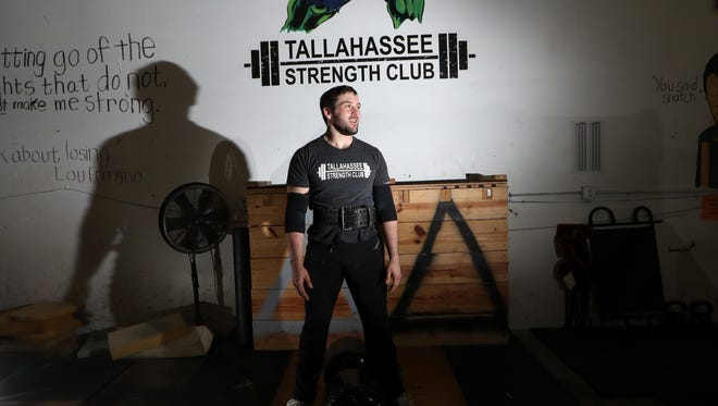 Brett Fain poses for a portrait at Boot Camp Fitness and Training where he spends up to three hours a day, seven days a week working out for strongman competitions.